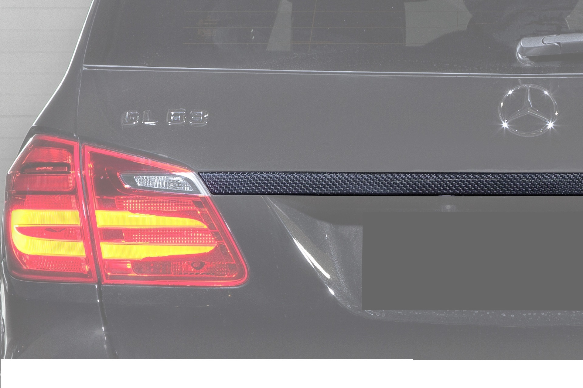 Hodoor Performance Carbon fiber trim on the trunk above the Brabus Widestar Style number for Mercedes CLS-class X166
